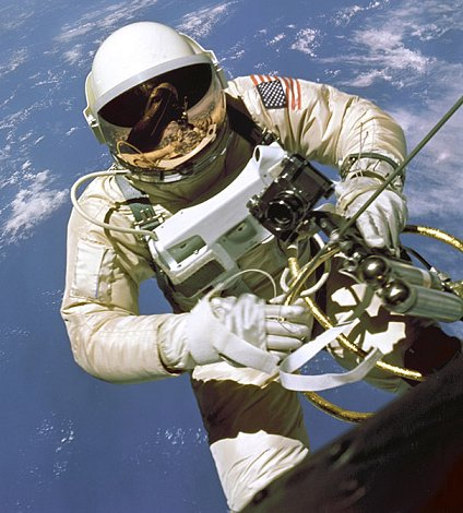 Ed White II during his space walk with Gemini 4 reflected in is visor...
